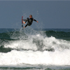 Danny Hart catching big air with silverfish sunglasses